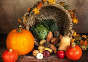 Healthy cornucopia with pumpkins and gourds